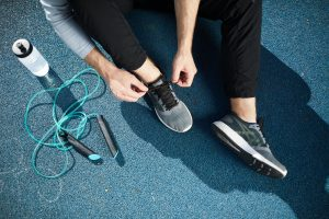 Tying sport shoes outdoors