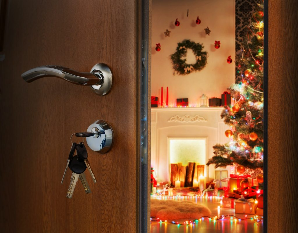 Opening door in christmas room, welcome to holiday